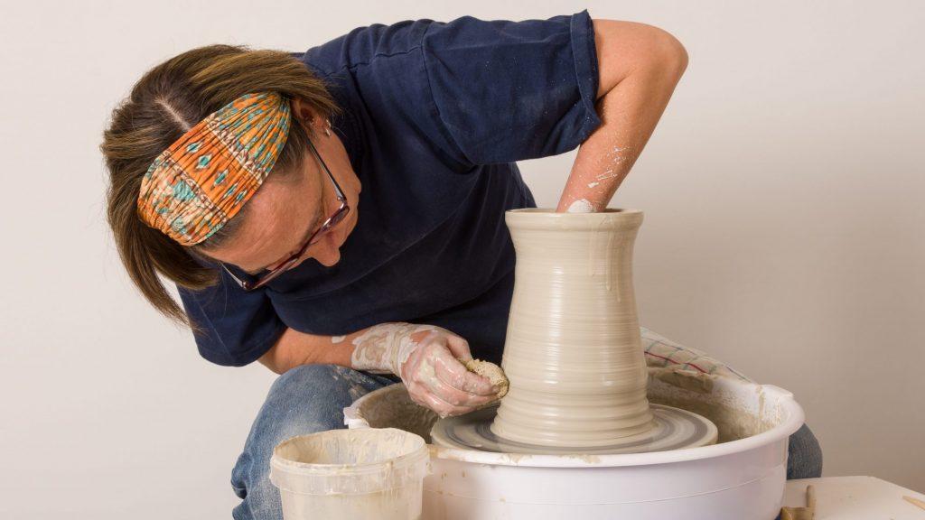 Ceramic artist throwing on wheel